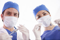 Ready for surgery. Couple of dentists ready to perform surgery Stock Photography