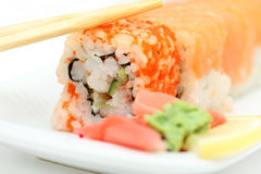 Ready sushi roll and chopsticks Stock Images