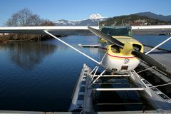 Ready for take-off. A seaplane moored in Squamish, BC on a sunny winter day royalty free stock photos