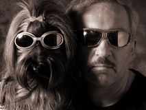 Ready for takeoff. Dog and man with sun glasses Monochrome version royalty free stock image