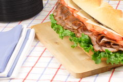 Ready to be served beef sandwich. Delicious  grilled beef sandwich ready to be served on those black party plates Stock Images