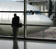 Ready to board. Taking care of last minute business before departure Royalty Free Stock Photography