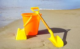 A Shovel and Pail on the Beach Royalty Free Stock Image