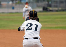 Ready to Catch the Ball. Baseball player on first base ready to catch ball Royalty Free Stock Photo