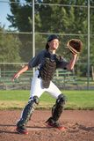 Ready to Catch. Baseball catcher with glove out ready for the ball to come in royalty free stock image