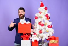 Ready to celebrate. Christmas preparation and celebration. Christmas gifts and decorations. How to organize awesome. Office christmas party. Man bearded hipster royalty free stock photography