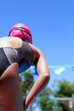 Ready to compete!. Young girl waiting to dive off block Stock Photos