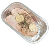 Ready to Cook Chicken Breast Joint. Seasoned stuffed chicken breast joint in foil container ready to be cooked Royalty Free Stock Image