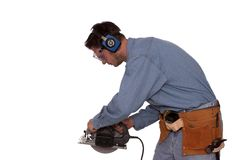 Ready to cut 2. Young carpenter wearing safety gear Stock Photography
