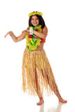 Ready to Dance Hawaiian. A preteen girl in Hawaiian leis and a grass skirt preparing to dance Hawaiian style.  Isolated on white Stock Images