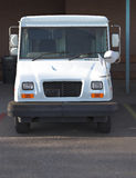 Ready to Deliver the Mail. Post Office Delivery Vehicle in the Parkiing Lot Stock Photos