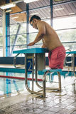 Ready to dive. Quadriplegic swimmer ready to dive in. He is getting on the platform with goggles on Royalty Free Stock Images