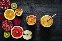 Ready to drink fresh organic smoothies and ingredients Royalty Free Stock Photography