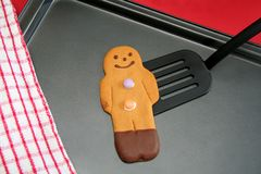 Ready to eat. Beautifully decorated Gingerbreadman is ready to be served onto your plate royalty free stock photo
