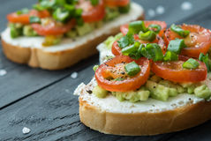 Ready to eat bruschetta with cream cheese, avocado tomatoes Royalty Free Stock Photography