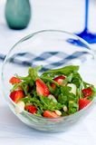 Ready to eat. Healthy eating concept. Vegetable salad. Delicious fresh vegetarian salad with asparagus, strawberries and arugula. Diet food Royalty Free Stock Photos