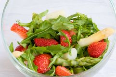 Ready to eat. Healthy eating concept. Vegetable salad. Delicious fresh vegetarian salad with asparagus, strawberries and arugula. Diet food Royalty Free Stock Photo