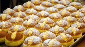 Ready to eat lush buns with cream close-up royalty free stock photo