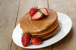 Ready to eat pancakes with strawberry Royalty Free Stock Photos