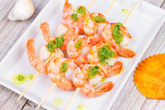 Ready to eat shrimps with green butter. Stock Images