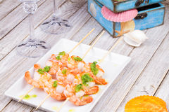 Ready to eat shrimps with green butter. Royalty Free Stock Photos