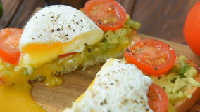 Ready to eat toast with poached egg and veggies. Served for two stock video