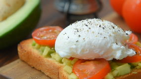 Ready to eat toast with poached egg and veggies. Served for two stock footage