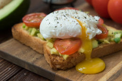 Ready to eat toast with poached egg and veggies Royalty Free Stock Image