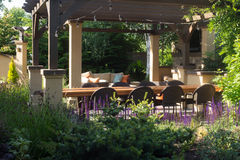 Ready to Entertain. A luxurious backyard setting for entertaining guests surrounded by perennials stock images