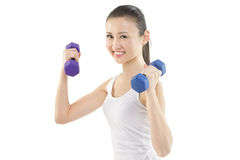 Ready to exercise. Beautiful Asian woman holding hand  weights Royalty Free Stock Photo