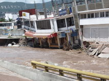 Ready to Fall in. A sagging building is ready to fall into the huacapa river in chilpancingo mexico as it recedes from a flood on 9/19/2013 as a result of Stock Photography