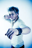 Ready to Fight. An angry young man with arms up, ready to fight.  Digitally processed color - blue tint Stock Image