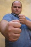 Ready to fight?. Man gesturing, note: there is a lot of noise at 100% view but it fits excellent to the theme Royalty Free Stock Photos