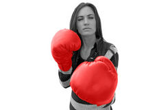 Ready to Fight. A girl with red boxing gloves is ready to fight stock image
