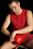 Ready to fight. Young handsome man on black isolated background Royalty Free Stock Images