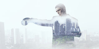 Always ready to fight. Businessman wear boxing gloves against modern cityscape Stock Photo