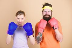 Ready to fight. Man and woman in boxing gloves. Boxing sport concept. Couple girl and hipster practicing boxing. Sport royalty free stock image