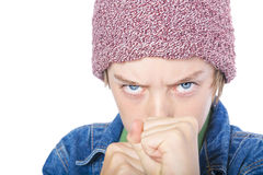 Ready to fight portrait of a male teenager. With red  toque Royalty Free Stock Photos