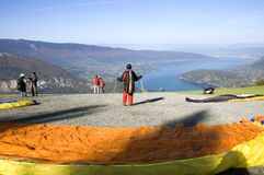 Ready to fly paraglider in front of Lake Annecy. Annecy, Frace - October 11, 2009 : A ready to fly paraglider in front of Lake Annecy at moutain pass Forclaz Stock Images