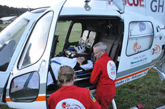 Ready to go. Rescue helicopter personnel prepare a patient for hospital, Westland, New Zealand Stock Photo