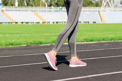 Ready to go. Close up photo of shoe of female athlete on the starting line. Girl on Stadium track, preparing for a run. Sports and. Healthy concept royalty free stock photography