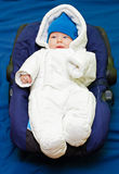 Ready to go. Cute baby dressed up in fluffy warm winter clothes ready to go outside Stock Photography