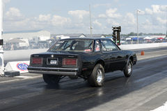 Drag racing. Rear side view of black mirada car on the track ready to start Stock Image