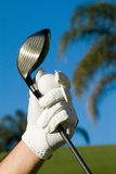 Ready to Golf. A Hand with golf  equipment Stock Image