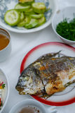 Ready-to-grill dorado fish. Fish and eggplants are on the village table. View from above Stock Photos