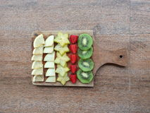 Ready to healty. Lemons, apples, star fruit, strawberrys and kiwis stock image