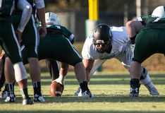 Ready to Hike The Ball. American football linemen get ready for the play Stock Image