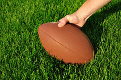 Ready to Hike Football on a grass playing field Stock Photography