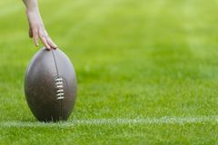 Ready to Hike Football on a grass playing field, horizontal, copy space royalty free stock photo