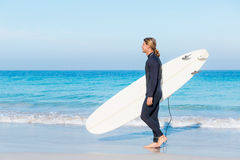 Ready to hit waves. A young surfer with his board on the beach Royalty Free Stock Photography